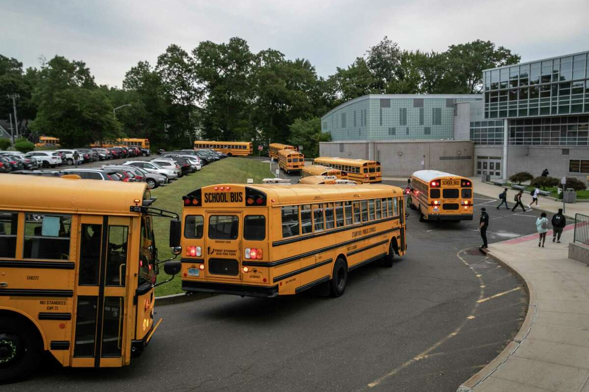 Buses drop-off students at Rippowam Middle School on September 14, 2020 in Stamford, Connecticut.