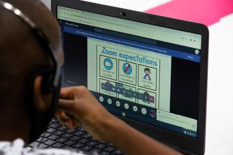 A Houston ISD student, pictured Sept. 8, learns about expectations for live online classes while attending a learning center on the district's first day of virtual instruction.