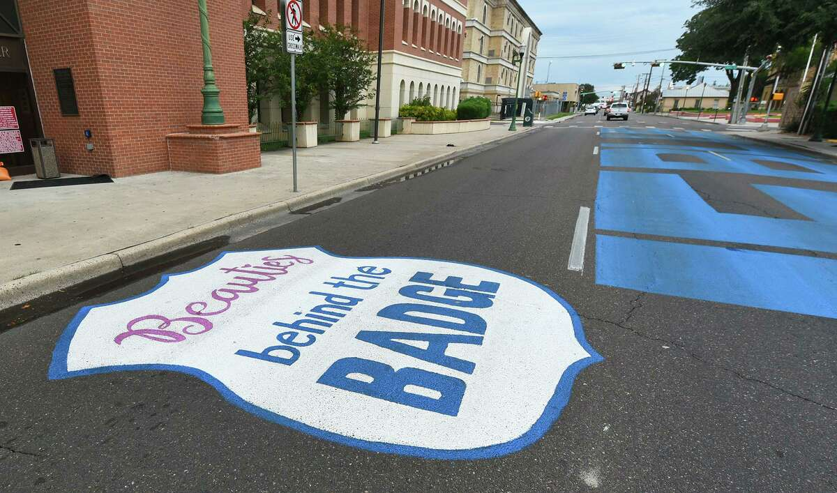 """The completed Beauties Behind the Badge design is placed on the leftmost lane of Victoria Street above the """"Back the Blue"""" mural on Monday, Sept. 14."""