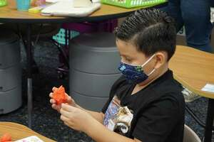 A McElwain Elementary student works some play dough on the first day of in-person instruction for Katy Independent School District, Tuesday, Sept. 8.