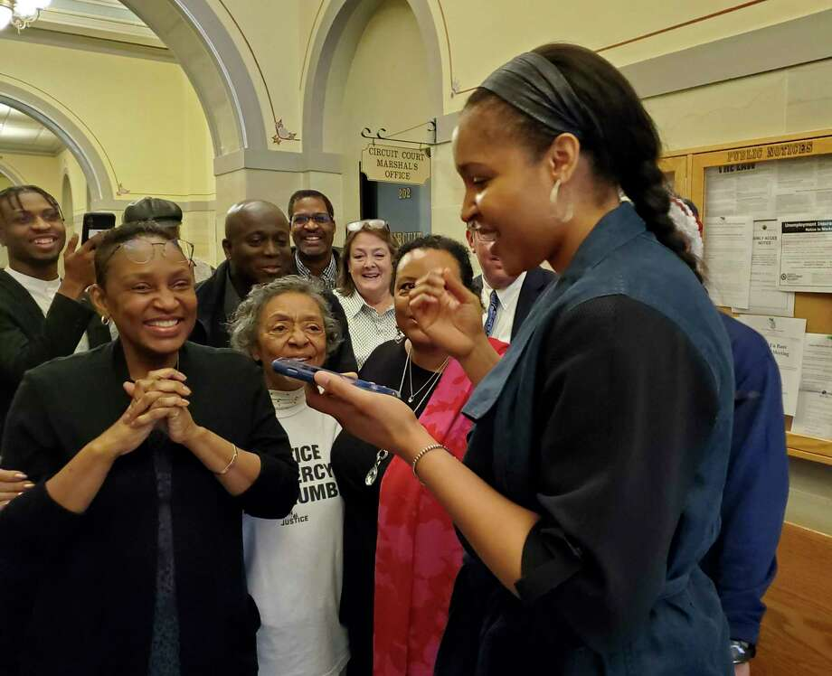 Maya Moore calls Jonathan Irons as supporters react after Irons' convictions were overturned on March 9 in Jefferson City, Mo. Photo: Jeff Haldiman / Associated Press / The Jefferson City News-Tribune