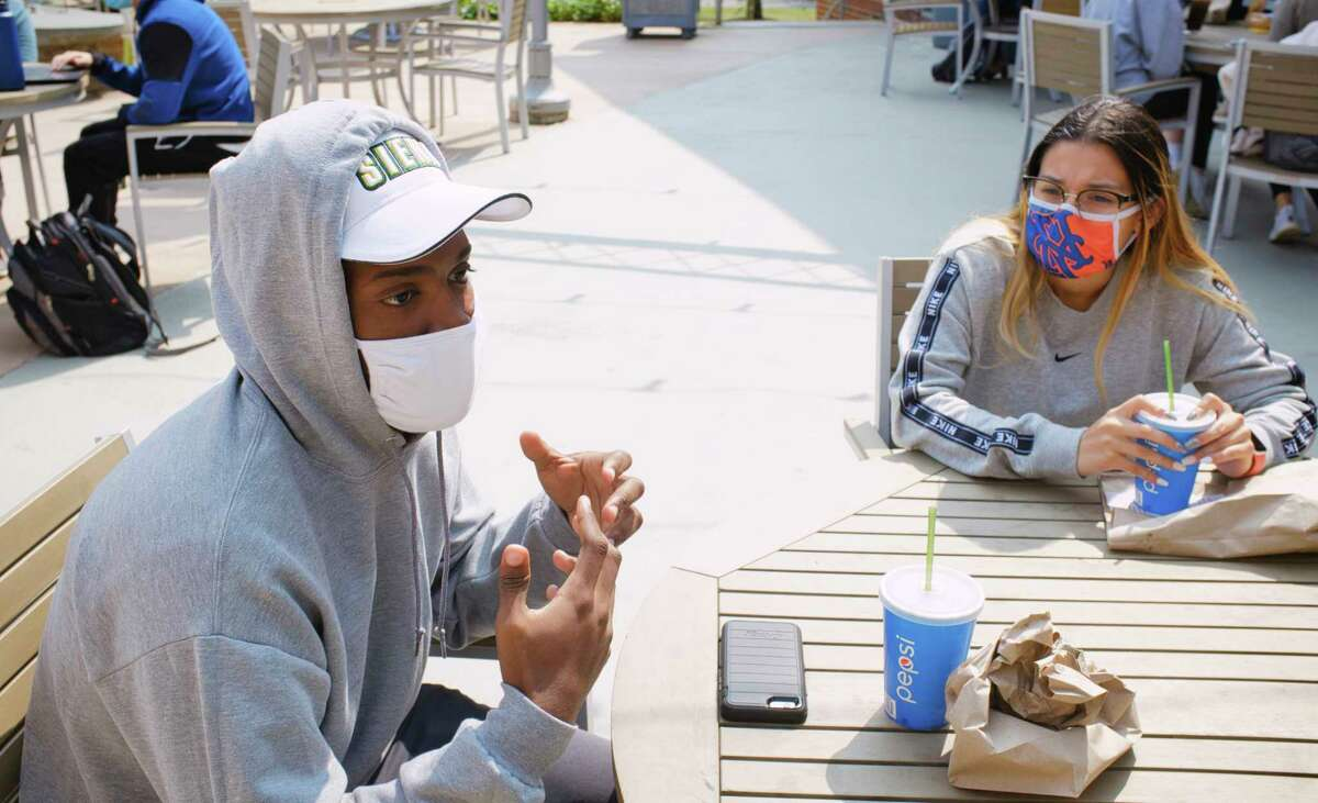 Siena College freshmen, Miykael Locke, left, from Schenectady, and Angelee Carino, from the Bronx, talk about following the rules under the pandemic on Wednesday, September 16, 2020, in Loudonville, N.Y. (Paul Buckowski/Times Union)