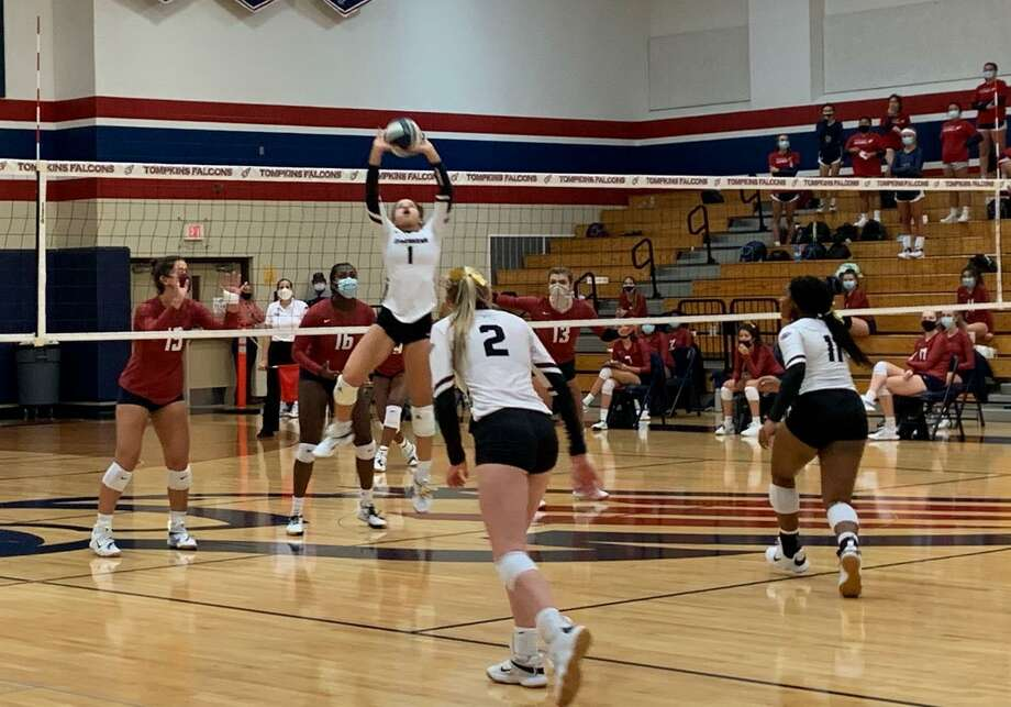 George Ranch's Alexandra Tennon sets against Tompkins during their season-opening non-district volleyball match Sept. 15 at Tompkins High School. Photo: Jack Marrion/Staff Photo