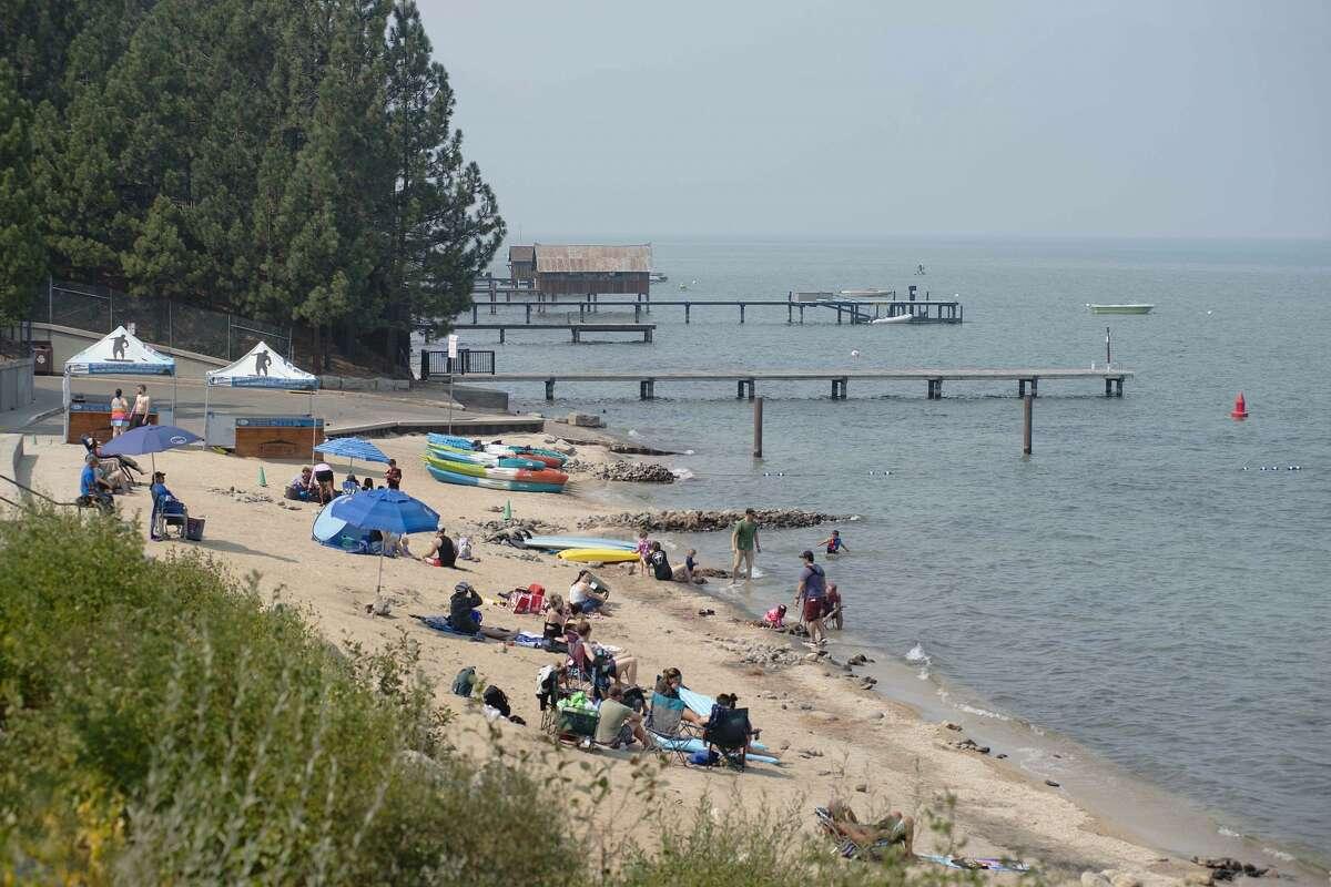 Beachgoers swim, kayak and lounge despite poor air quality conditions from wildfires at Lakeview Commons in South Lake Tahoeon Sept. 15, 2020.