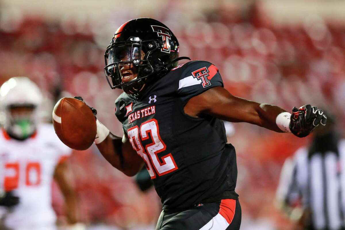 KeSean Carter (82) of the Texas Tech Red Raiders yells after scoring a touchdown during the second half of the college football game against the Houston Baptist Huskies on September 12, 2020 at Jones AT&T Stadium in Lubbock, Texas.