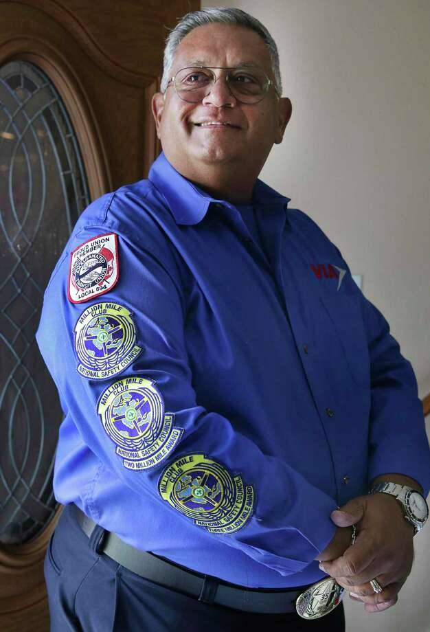 Roy Chapa, a VIA bus operator, etired after 41 years of driving the streets of San Antonio accumulating a whopping 3 million miles. The patches on his work shirt indicate his accomplishments of millions of miles, from the National Safety Council. Photo: Bob Owen /San Antonio Express-News / ©2020 San Antonio Express-News