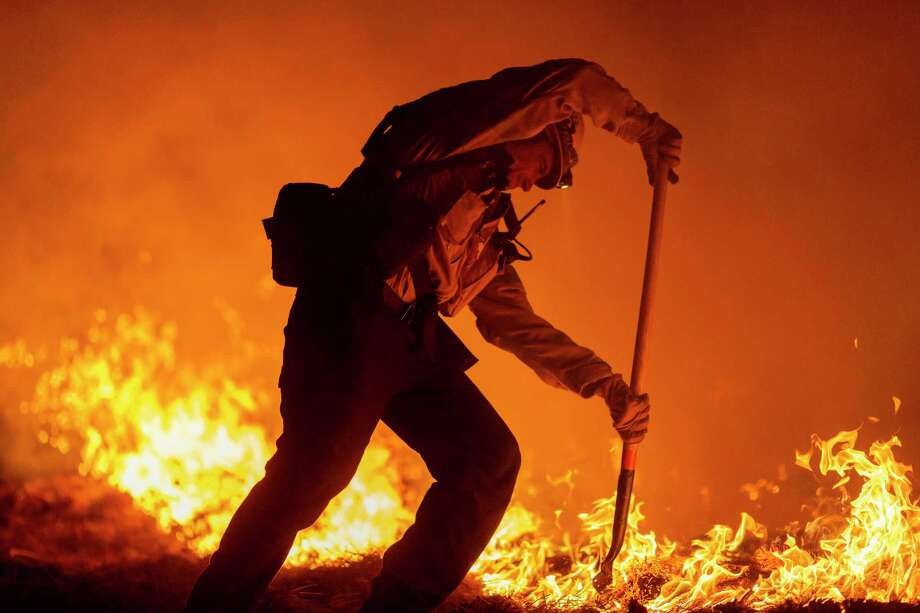 A firefighter struggles last week against the Bobcat Fire in Angeles National Forest. On the right and left, wildfires have been politicized. Photo: David McNew / Getty Images / 2020 Getty Images