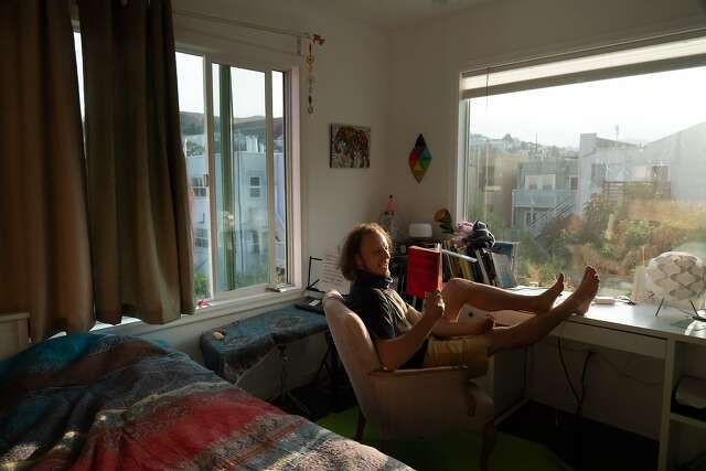 Andrii Zamovsky, co-founder and resident of the Manor of Being house, in his room. Eleven people, who work in tech, mathematics, music and art, share the Mission District home.