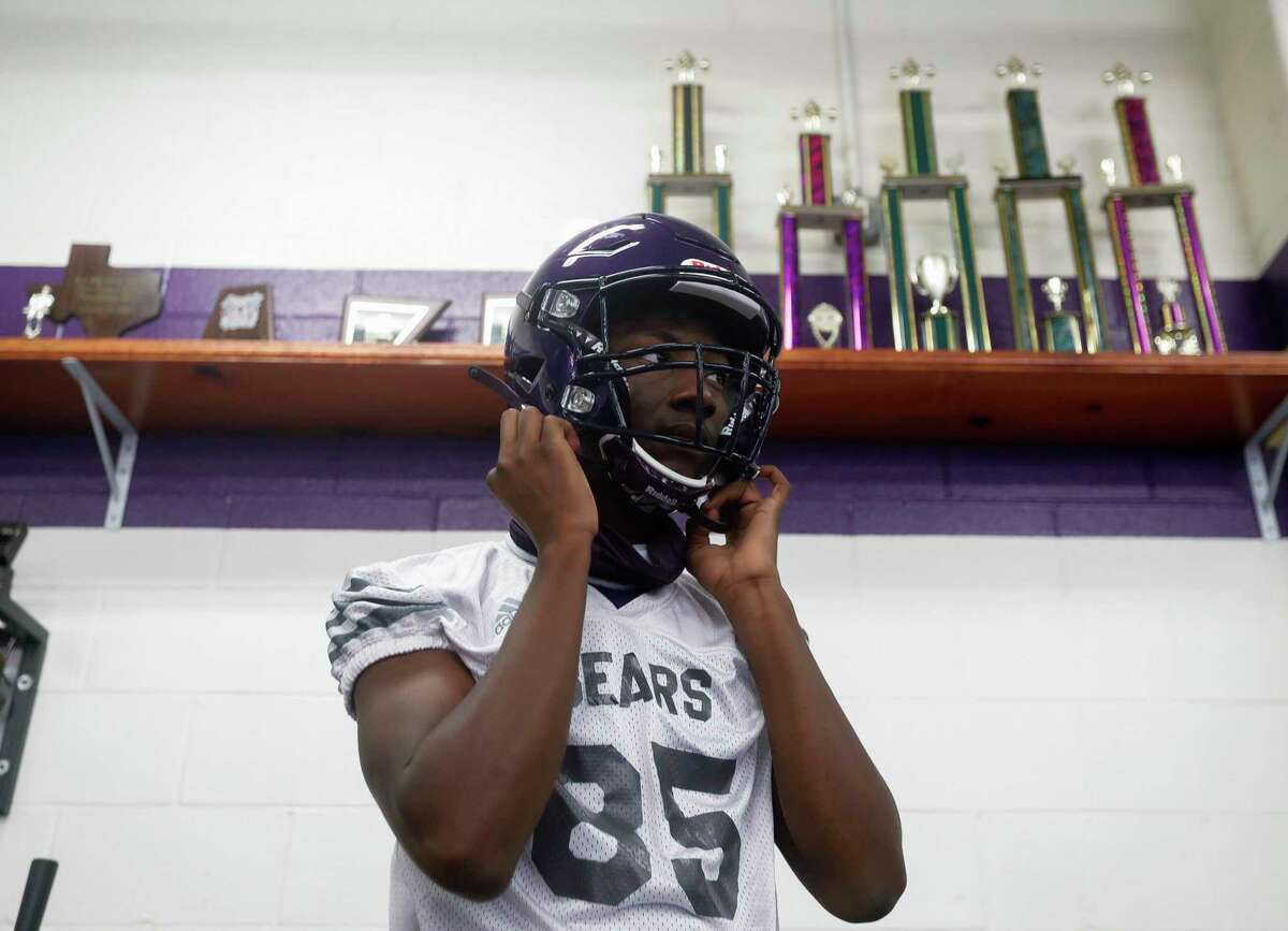 Montgomery wide receiver Tre Harden adjusts his helmet as he waits for the first day of football practice to begin at Montgomery High School, Monday, Sept. 7, 2020, in Montgomery. High school programs in 5A and 6A classifications began practices as part of the University of Interscholastic League's phased approach to starting high school athletics across Texas.
