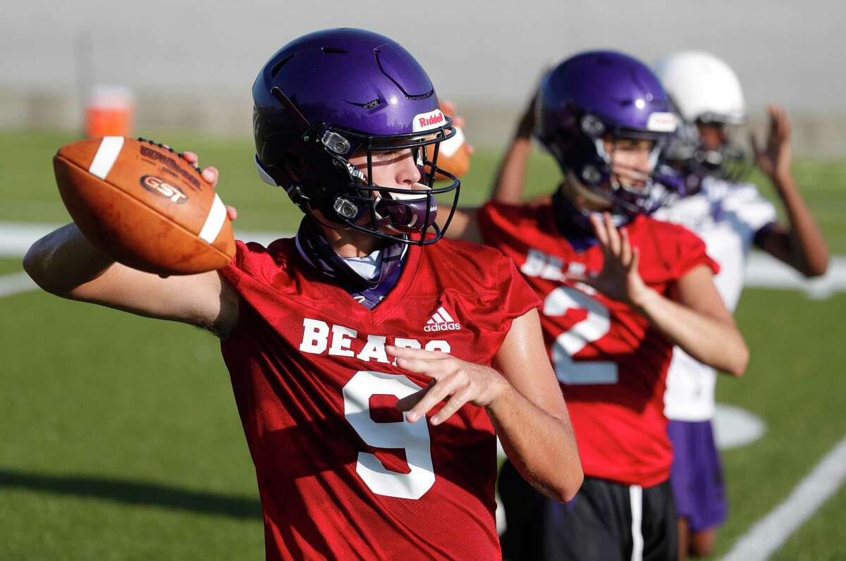 Montgomery starting quarterback Brock Bolfing (9) warms up during the first day of football practice at Montgomery High School, Monday, Sept. 7, 2020, in Montgomery. High school programs in 5A and 6A classifications began practices as part of the University of Interscholastic League's phased approach to starting high school athletics across Texas.