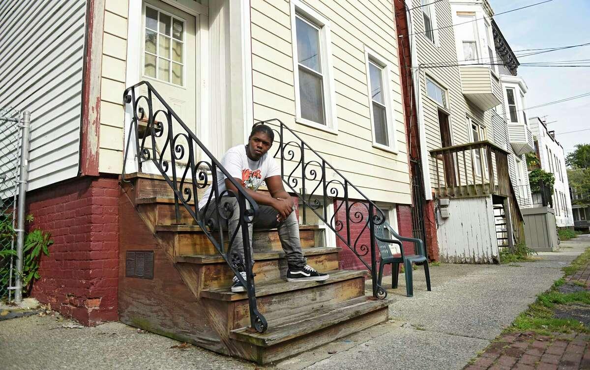 Zanief Washington, 19, sits outside his home on Thursday, Sept. 10, 2020 in Albany, N.Y. (Lori Van Buren/Times Union)