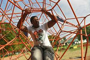Zanief Washington, 19, is seen on a jungle gym at Livingston and Lake Park where he likes to hang out on Thursday, Sept. 10, 2020 in Albany, N.Y. (Lori Van Buren/Times Union)