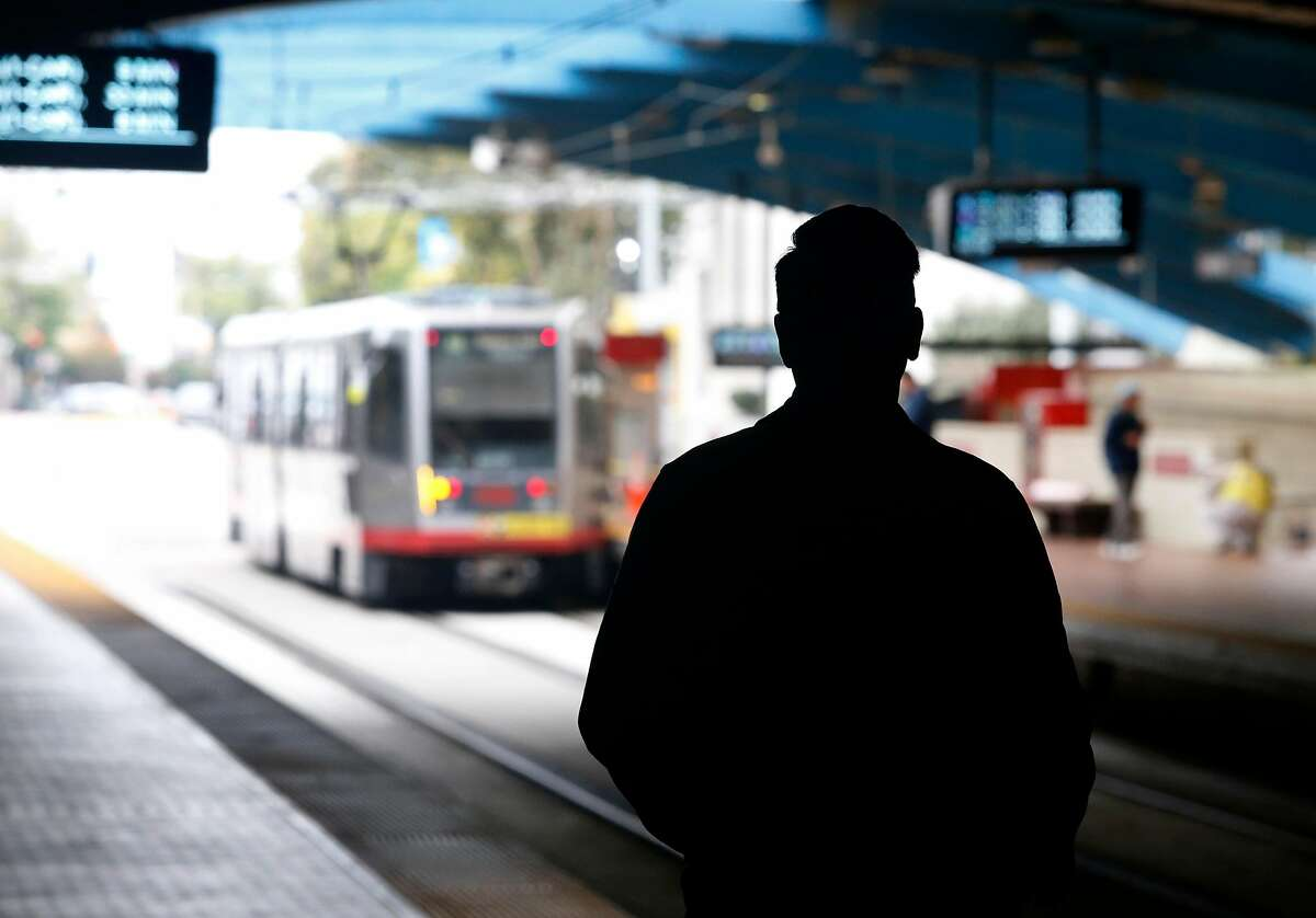 A passenger waits for an inbound train to arrive at the West Portal Muni Metro station in San Francisco, Calif. on Saturday, Aug. 25, 2018. Muni is getting a new rider-information system for $89 million, while ancient, floppy-disk computers still route the trains.