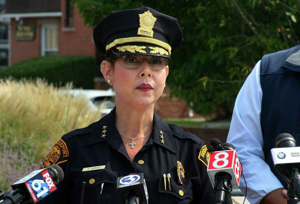 Acting Police Chief Rebeca Garcia speaks to the media in front of police headquarters in Bridgeport, Conn.