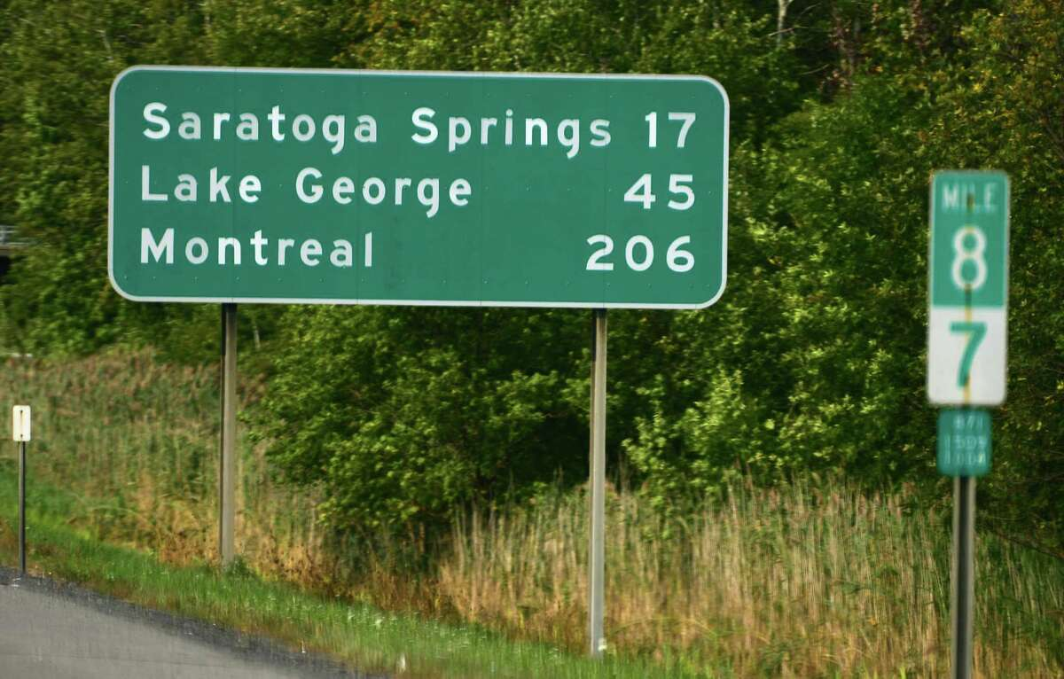 A mileage sign for Saratoga Springs, Lake George and Montreal is seen on the side of the road on I-87 headed north on Wednesday, Sept. 16, 2020 in Latham, N.Y. (Lori Van Buren/Times Union)