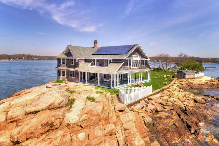 Potato Island, one of the Thimble Islands off the coast of Branford, CT, just sold for $4.2 million on Sept. 8, 2020, according to Page Taft-Christie's International Real Estate's Madison office. The sale is the highest-value sale of 2020 in Branford and the second-highest in New Haven County, according to date from the Connecticut Multiple Listing Service, Page Taft-Christies International Real Estate said in a news release. (The highest sale in New Haven County so far this year was 270 Old Quarry Lane in Guilford, which sold for $4.9 million on Aug. 10, according to Campbell and Redfin.com.) The Potato Island property includes the 1.1-acre island, a solar-powered 3,781-square-foot house originally built in 1912 — which has four bedrooms, 31/2 bathrooms and a wraparound porch — a heated pool, a custom granite whirlpool spa, boat facilities and a deep-water dock, plus 360-degree water views of Stony Creek, other islands and Long Island Sound. It also includes a small Boston Whaler boat and a leased slip and parking space on shore, which Campbell said is a two-minute boat ride away.  Photo: Randal Alquist Photography /Contributed Photo