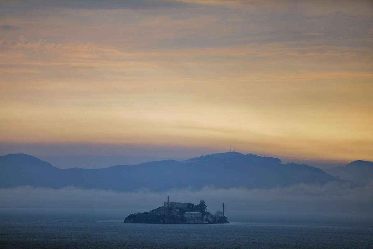 Haze and smoke surround Alcatraz as seen from Treasure Island on Sunday, Aug. 23, 2020 in San Francisco, California. The prospect of high temperatures and windy conditions this weekend are raising the risk of wildfires.