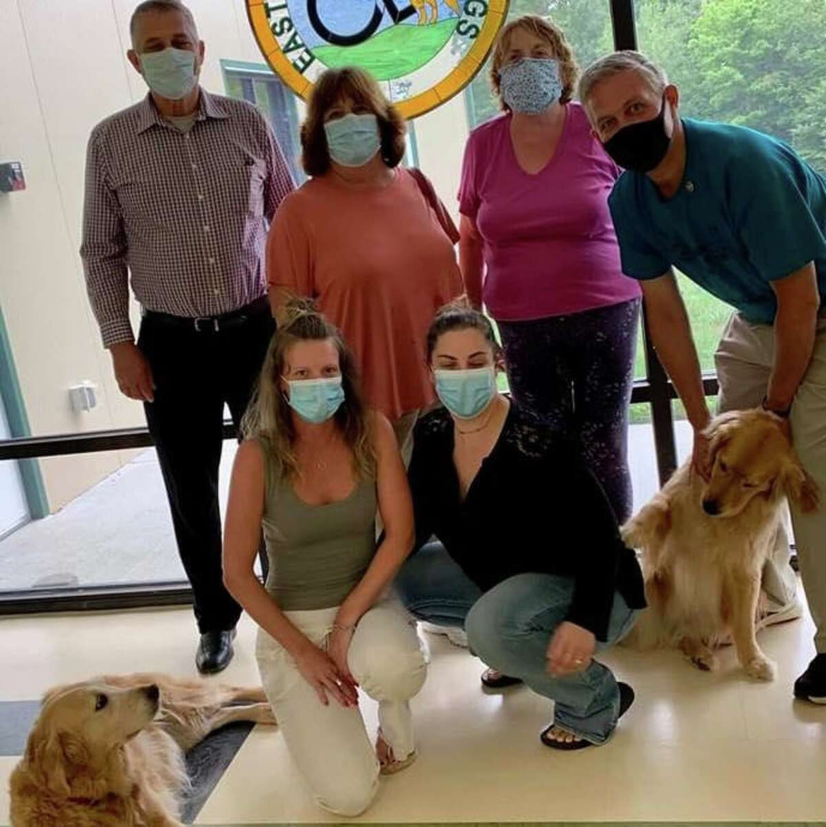 Dale Picard, ECAD's co-founder and executive director, and ECAD staff members celebrate the installation of his not-for- profit organization that trains and places Service Dogs as a new Lions Club Branch with members of the Barkhamsted and Terryville Lions Club.