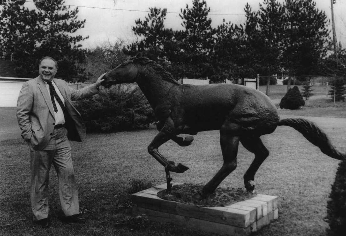 Schodack, New York - Victor Gush, developer, with the mascot of the Stablegate development, out front of his office in Stablegate, Schodack. March 16, 1990 (Roberta Smith/Times Union Archive)