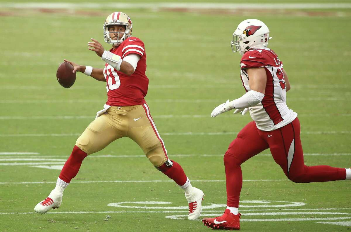 SANTA CLARA, CALIFORNIA - SEPTEMBER 13: Jimmy Garoppolo #10 of the San Francisco 49ers is chased by Zach Allen #94 of the Arizona Cardinals at Levi's Stadium on September 13, 2020, in Santa Clara, California. Allen recorded his first sack of his National Football League career during the game. The Cardinals also won the game by a score of, 24-20.