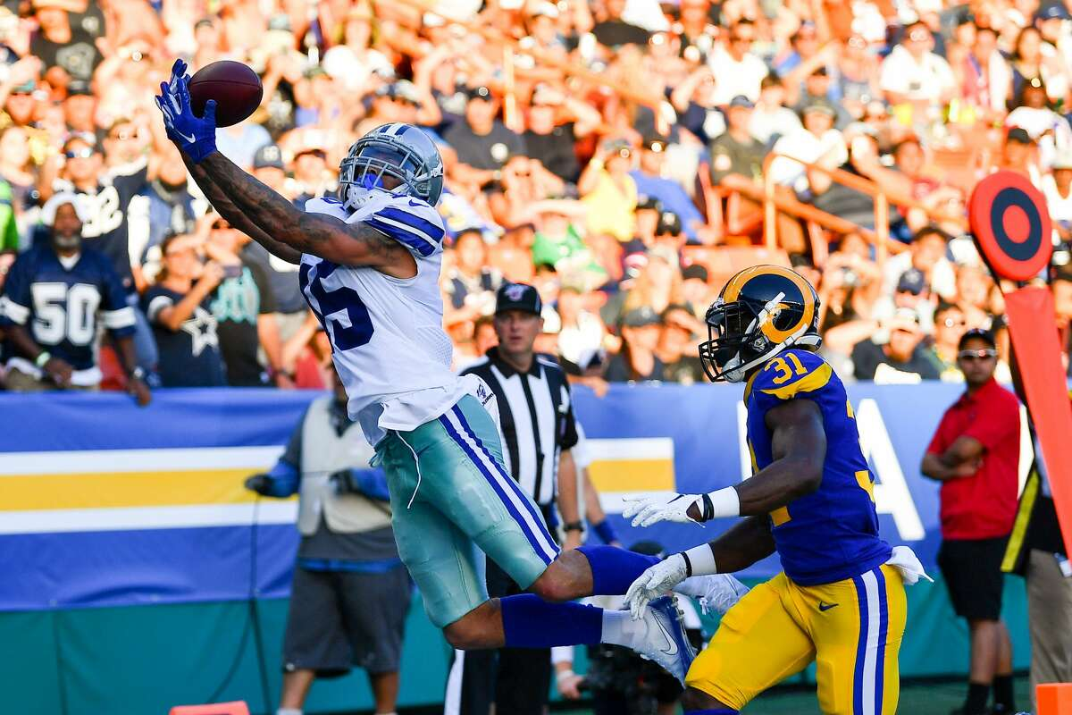 HONOLULU, HAWAII - AUGUST 17: Devin Smith #15 of the Dallas Cowboys makes a leaping touchdown catch over Darious Williams #31 of the Los Angeles Rams during the second half of the preseason game at Aloha Stadium on August 17, 2019 in Honolulu, Hawaii. (Photo by Alika Jenner/Getty Images)