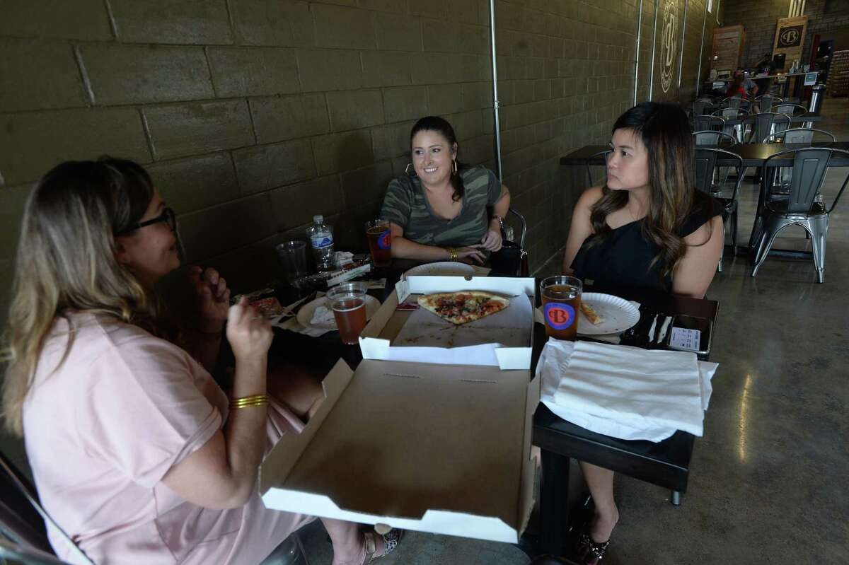 (From right) Tiffany Neale, Lauren Martin and Beth Rogers talk as they have lunch and brews at Pour Brothers Brewery in Beaumont, one of the establishments which reopened Friday after getting a license change from the TABC days ago. The women said they wanted to get out and support local businesses. Photo taken Friday, September 11, 2020 Kim Brent/The Enterprise