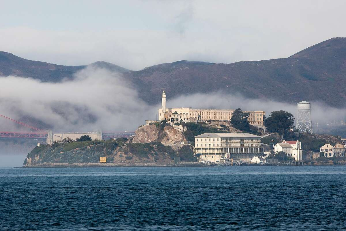 Alcatraz Island sits in a layer of fog under blue skies seen from Treasure Island in San Francisco, September 16, 2020.