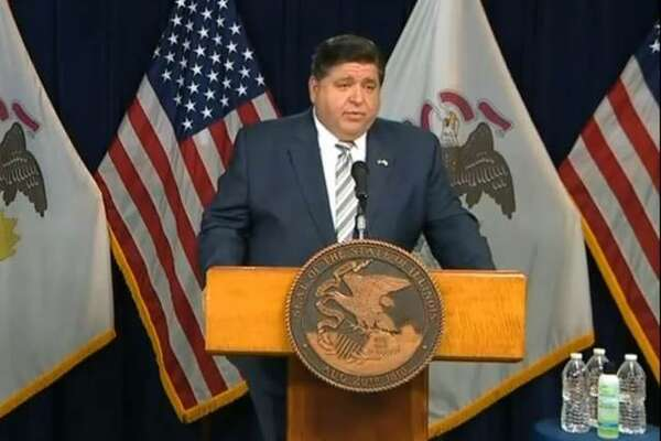 Gov. J.B. Pritzker defends his administration's decision to prohibit high school football for the fall season during a news conference in Chicago Wednesday.