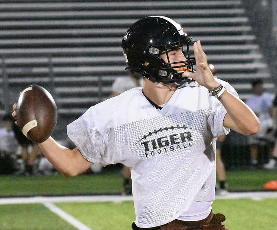 Edwardsville senior quarterback Ryan Hampton throws a pass during a practice Monday inside the District 7 Sports Complex. Photo: Matt Kamp|The Intelligencer