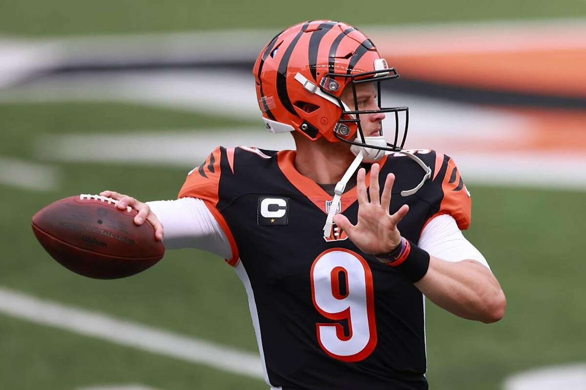 Quarterback Joe Burrow #9 of the Cincinnati Bengals throws a pass as he warms up before playing against the Los Angeles Chargers at Paul Brown Stadium on September 13, 2020 in Cincinnati, Ohio. (Photo by Bobby Ellis/Getty Images/TNS)