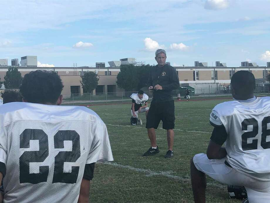 Spring Woods football coach Keith Cripps talks to the team after practice on Sept. 15 Photo: Elliott Lapin / Staff Photo