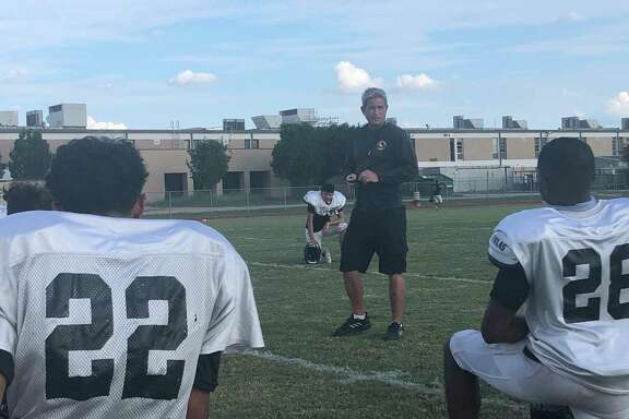 Spring Woods football coach Keith Cripps talks to the team after practice on Sept. 15