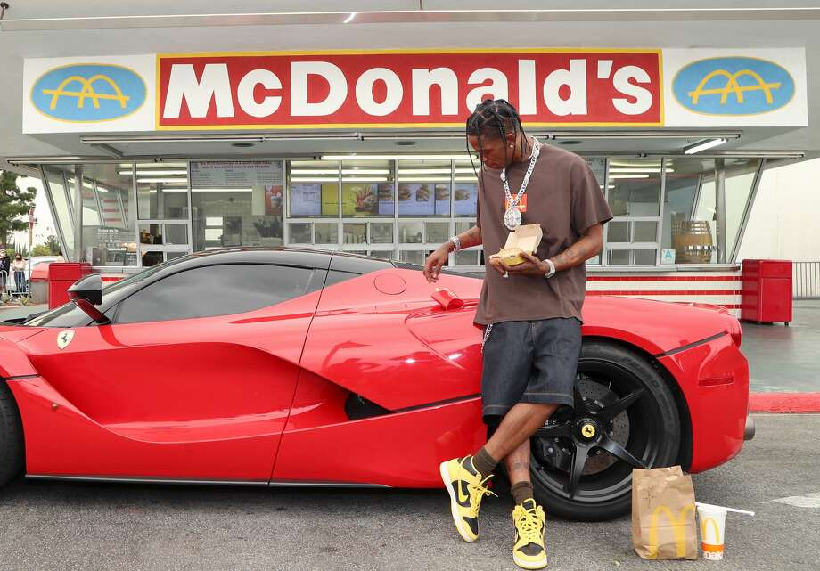 DOWNEY, CALIFORNIA - SEPTEMBER 08: Travis Scott surprises crew and customers at McDonald's for the launch of the Travis Scott Meal on September 08, 2020 in Downey, California. (Photo by Jerritt Clark/Getty Images for McDonald's) Photo: Jerritt Clark/Getty Images / 2020 Getty Images