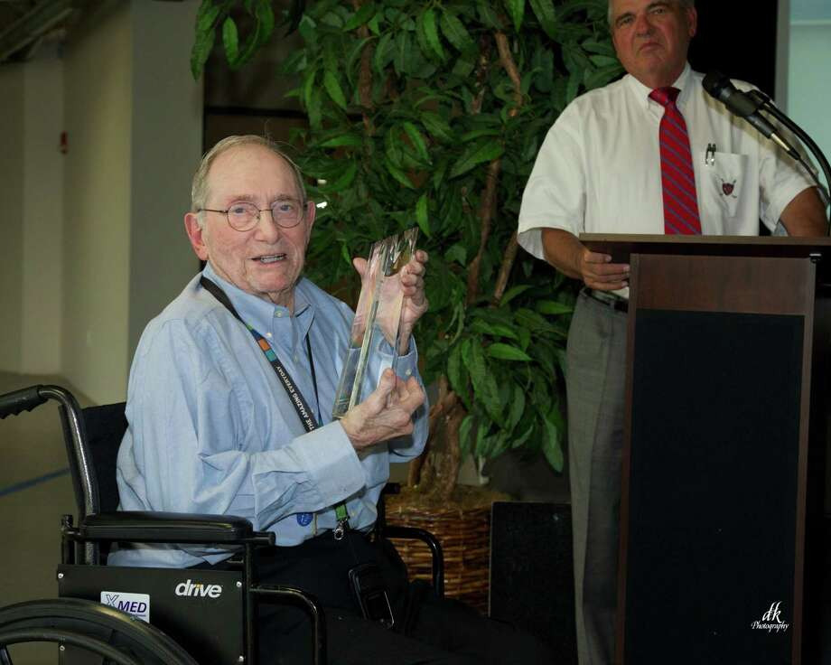 Tomball Regional Medical Center presented the hospitalâ??s first chief of staff, Dr. Norman Graham, with the inaugural 2015 Lifetime Achievement Award at its quarterly physician meeting last week. Photo: Submitted / Submitted