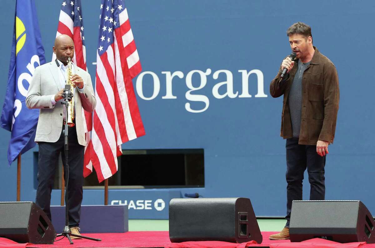 """(Left to Right), Branford Marsalis, a saxophonist, and Harry Connick, Jr., a singer, New Orleans native, and New Canaan resident, perform the song titled: """"America the Beautiful,"""" before the Men's Singles final match on Day 14 of the 2020 U.S Open Men's Final, at the USTA Billie Jean King National Tennis Center on September 13, 2020, in the Queens borough of New York City."""