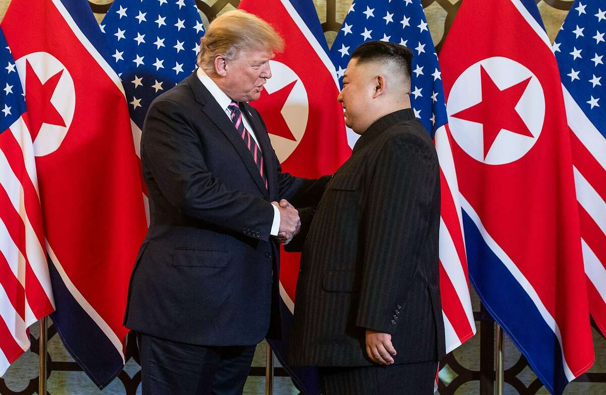(FILES) This file photo taken on February 27, 2019 shows US President Donald Trump (L) shaking hands with North Korea's leader Kim Jong Un before a meeting at the Sofitel Legend Metropole hotel in Hanoi. - North Korean leader Kim Jong Un deployed flattery and florid prose in the letters that forged his diplomatic courtship of Donald Trump, according to a new book on the US president on September 10, 2020. (Photo by Saul LOEB / AFP) (Photo by SAUL LOEB/AFP via Getty Images)