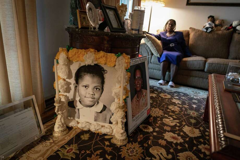 Sarah Collins Rudolph at her home in Forestdale, Ala., with a photo of her sister Addie Mae Collins and a copy of the program from her funeral in the foreground. Photo: Photo For The Washington Post By Michael A. Schwarz. / Michael A. Schwarz