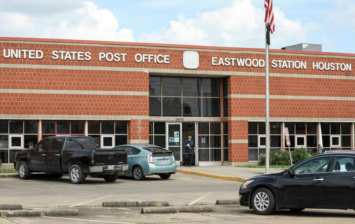 A man exits the Eastwood Station United States Post Office on Wednesday, Sept. 16 2020, in Houston.