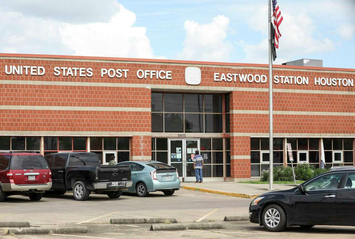People enter the Eastwood Station United States Post Office on Wednesday, Sept. 16 2020, in Houston.