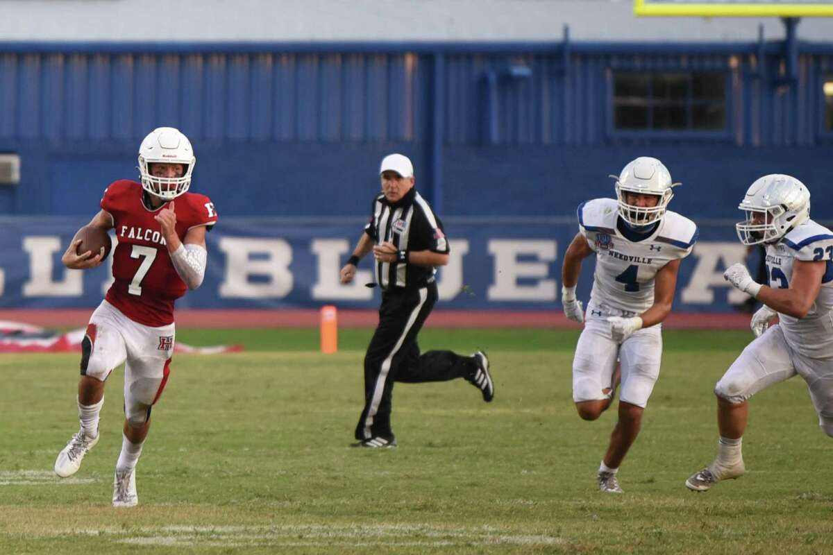Huffman quarterback Luke Thomas runs avaodiing Needville defenders.