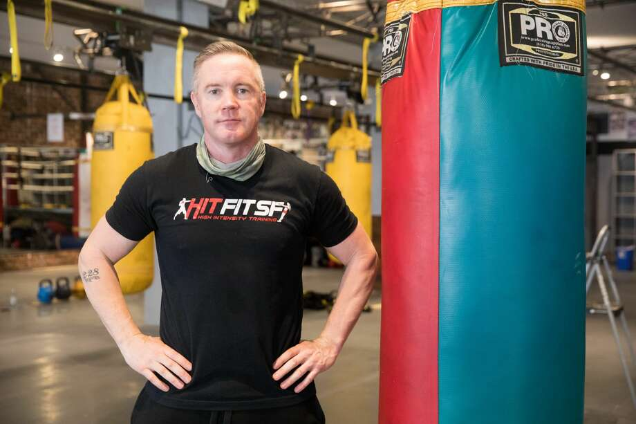 Hit Fit SF owner Simon Redmond and his employees fixed up his gym to make it compliant for city's new indoor capacity rules due to the COVID-19 coronavirus pandemic at its Sutter Street location in San Francisco on Sept. 16, 2020. Photo: Douglas Zimmerman/SFGATE / SFGATE
