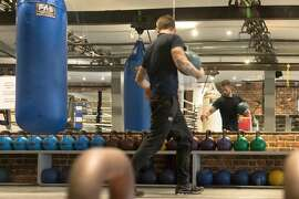 Hit Fit SF employee Sean Mason moves medicine balls and kettlebells at its Sutter Street location in San Francisco, California on Sept. 16, 2020. Owner Simon Redmond and his employees fix up his gym to make it compliant for city's new indoor capacity rules due to the COVID-19 coronavirus pandemic.