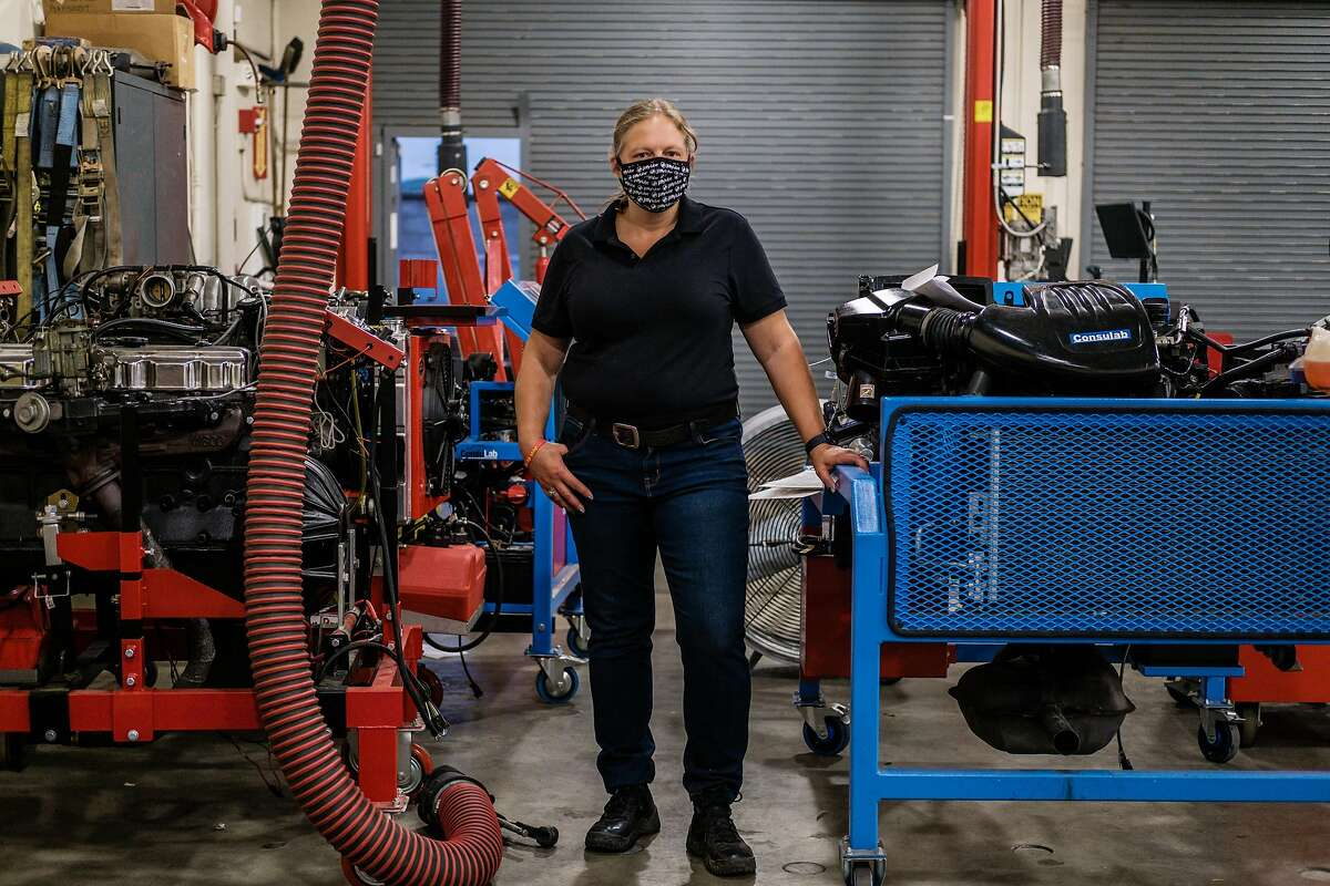 Jenn Oakley poses for a photograph before the start of her auto mechanics class at Chabot College in Hayward on Thursday, September 10, 2020. Oakley is a homeless woman who is attempting to pull herself out of poverty. For months she's had a full-time security job, and she was just hired at Jiffy Lube. She's lived at a transitional housing site since February. She's ready to move out, but she's having trouble securing financial help.