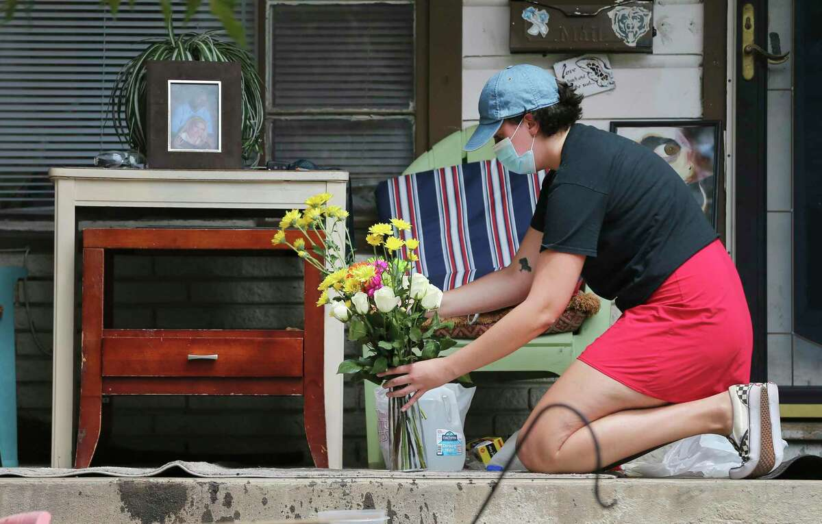 Flowers are placed at the porch of the home of Darrell Zemault Sr. on Willee Drive, who died after he was shot by a police officer during what the police department described as an altercation while attempting to arrest Zemault.