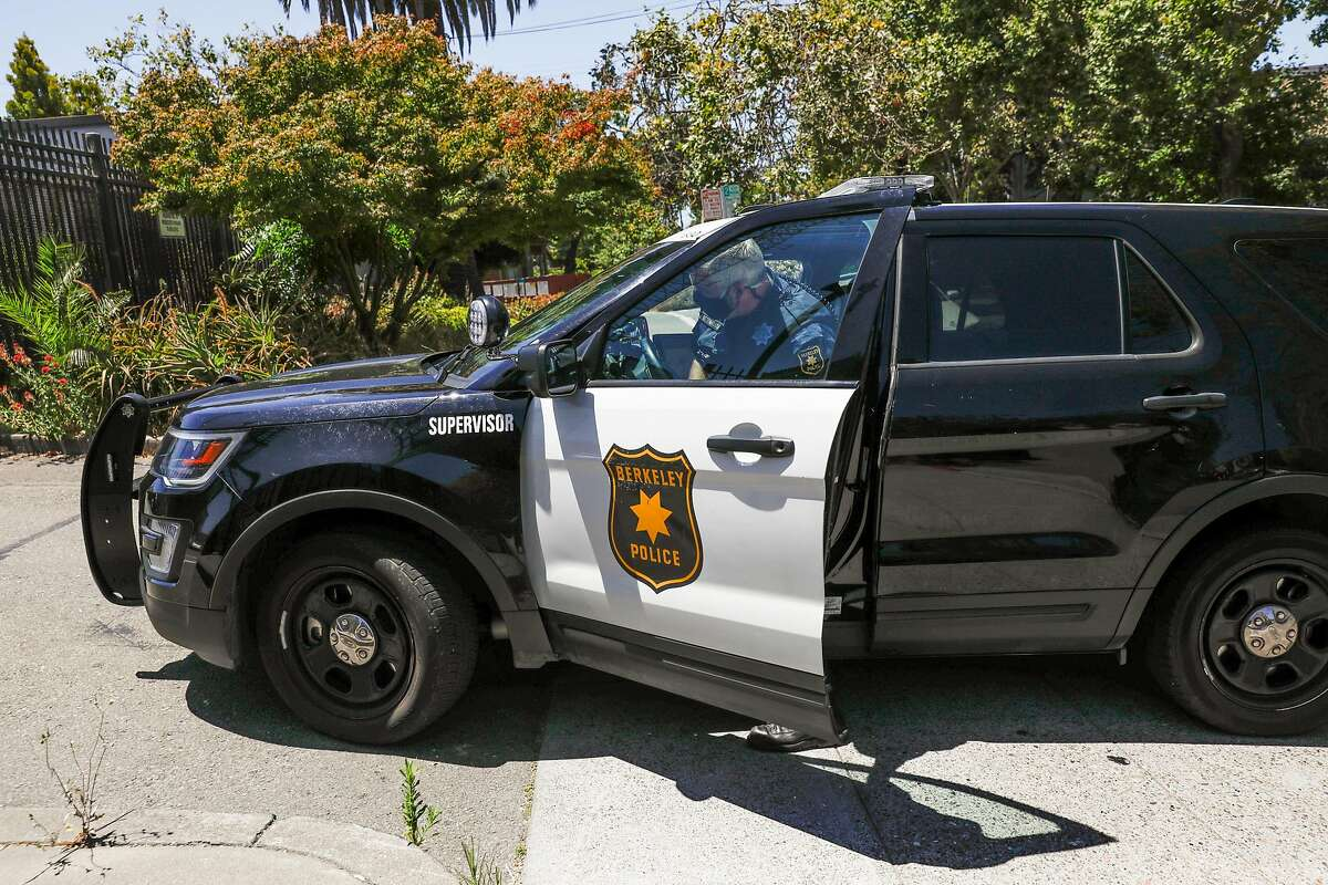 A police officer gets into his car at the Berkeley Police Department on Wednesday, July 8, 2020 in Berkeley, California.
