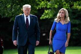 President Donald J. Trump walks with Press Secretary Kayleigh McEnany to board Marine One and depart from the South Lawn of the White House on Tuesday, Sept 15, 2020 in Washington, DC.