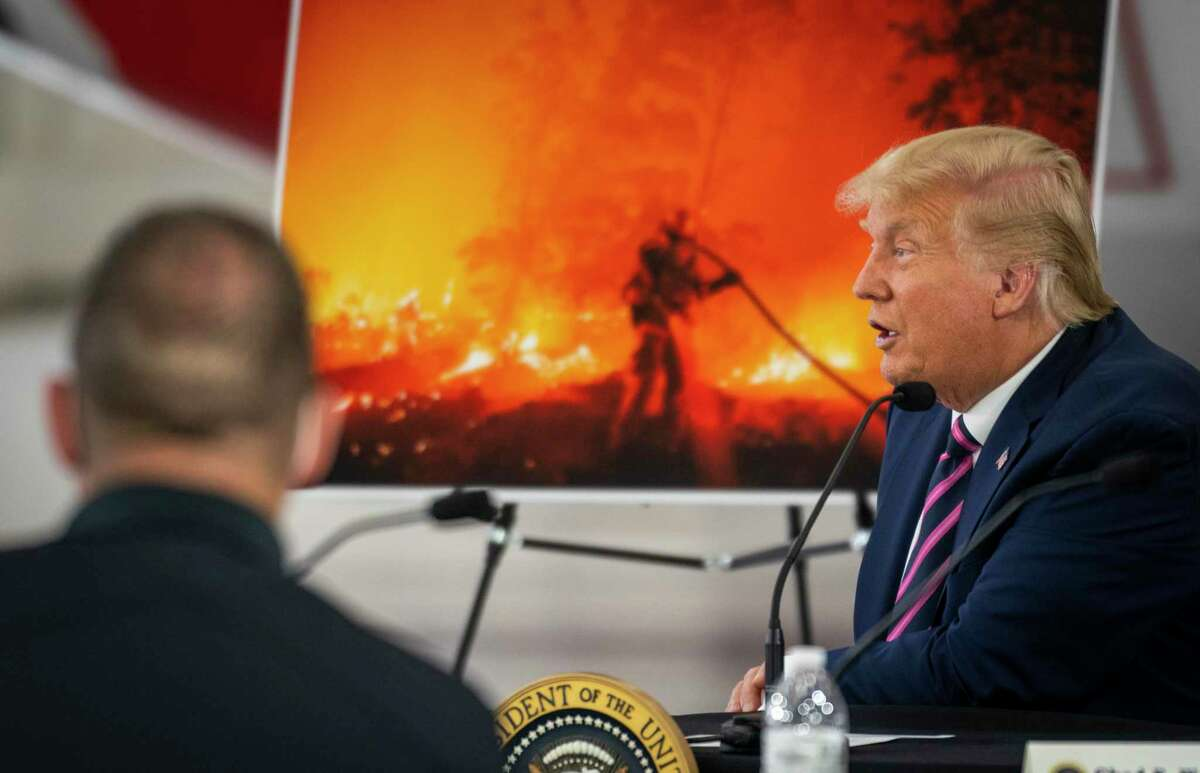 President Donald Trump speaks during a wildfires briefing at the Sacramento McClellan Airport in McClellan Park, Calif., Sept. 14. The explosion of wildfires across the West has opened a new battleground in the critical competition for suburban voters between Trump and Joe Biden.