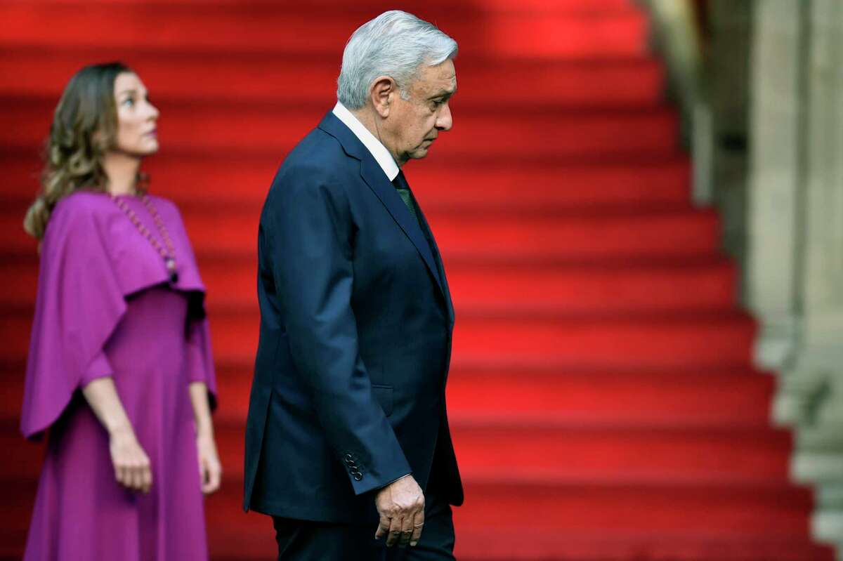 Mexican President Andres Manuel Lopez Obrador (R) and his wife Beatriz Gutierrez arrive for the presentation of the second annual report of his government at the National Palace in Mexico City on September 1. Lopez Obrador is openly suggesting rolling back the nation's energy market reforms and restoring Pemex's monopoly.