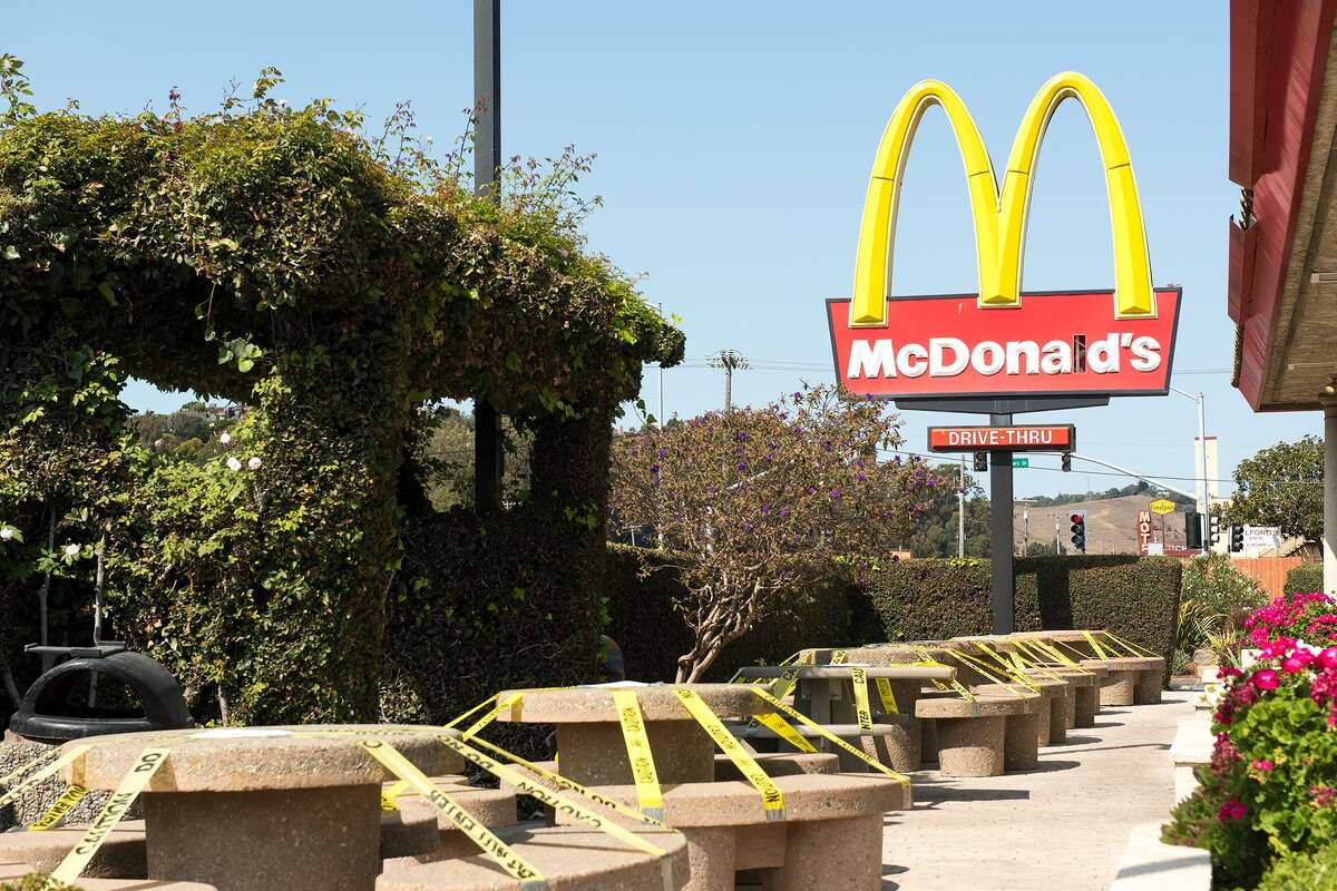 A closed outside eating area of McDonald's.