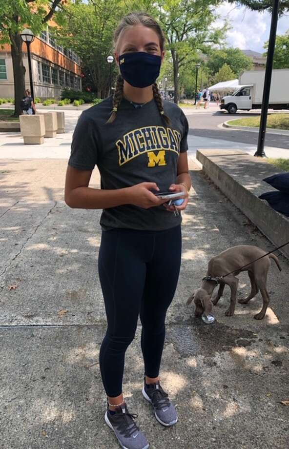 Dow High graduate Claire Newman stands outside the Michigan Union in Ann Arbor. Newman and her University of Michigan swim teammates ran the steps of Michigan Stadium at sunrise on Friday, Sept. 11. Photo: Photo Provided